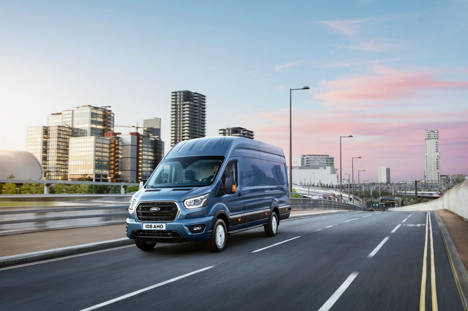 blue ford van on the road for a trade & upgrade